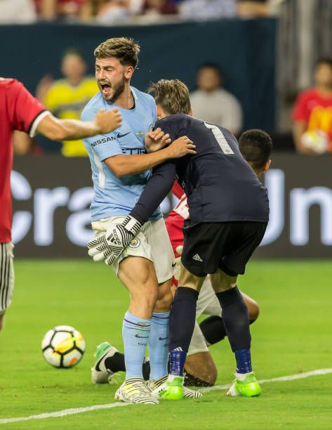 Manchester United goalkeeper David de Gea collides with Manchester City midfielder Patrick Roberts during the International Champions Cup match...