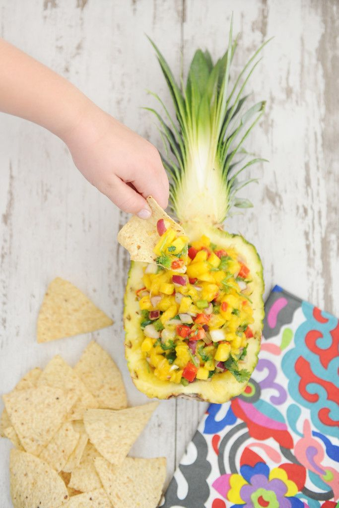 Delicious Mango Salsa Recipe.  Make this fresh fruity salsa in minutes to celebrate the flavors of the season.  Serve with chips or on top of grilled chicken for a delicious dinner.  Serve it in a hollowed out pineapple for a fun party dish.