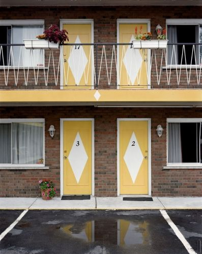 The_Voyageur - Alec Soth I like how he captures the detail of the motel/hotel rather than just the overall outside. Makes me wonder a little where we are. I also like the symmetry he shows with the doors and colours.