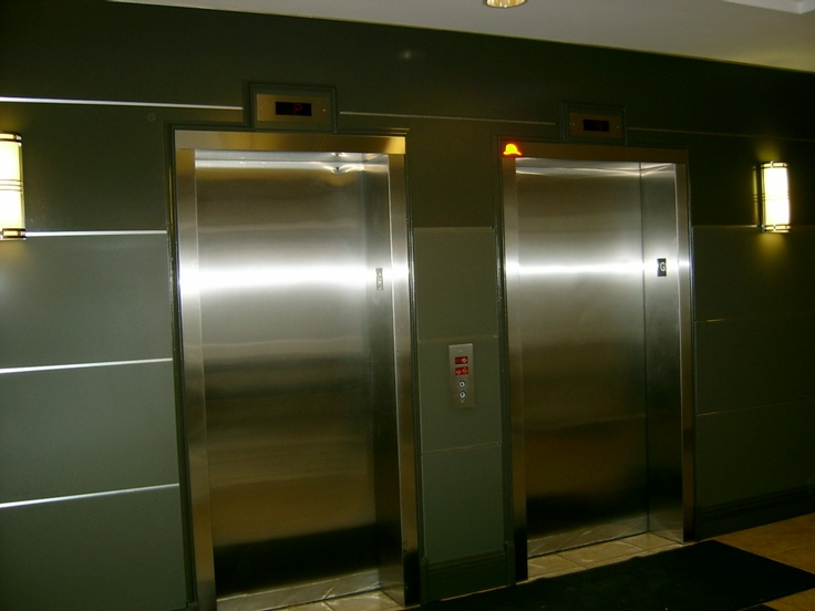 Faced The Elevator Wall With Back Painted Glass Condo