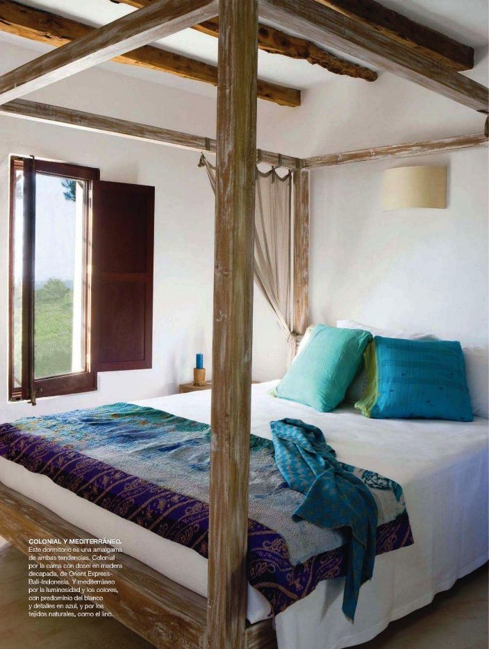 Pickled canopy bed in Balinese retreat; Interiores
