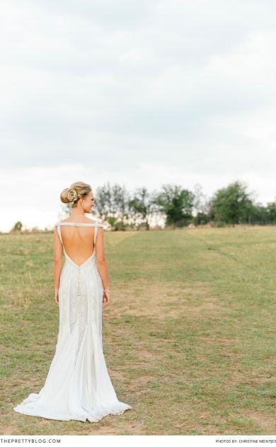 Beautiful wedding dress! Worn by former Miss SA Melinda Bam! See all their wedding photos on theprettyblog.com | Wedding Venue: Oakfield Farm | Photographer: Christine Meintjes Photography | Hair: Gary Rom Hair | Wedding Dress: Bondesio Couture |
