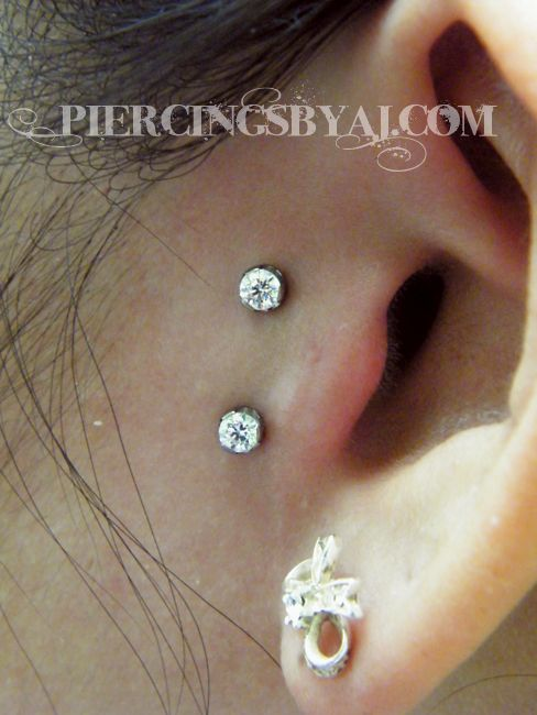 Fresh 16g vertical tragus surface piercing with 3mm prong set CZ gems that I just got to do. Jewelry from Anatometal.