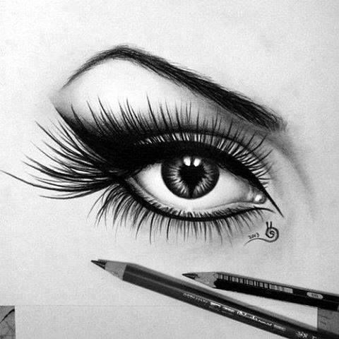 I didn't draw this, but I'm constantly drawing eyes all over paper. I'm still working on light reflections and eyelashes. That's where I have issues because they always tend to fade when I do the rest of a face