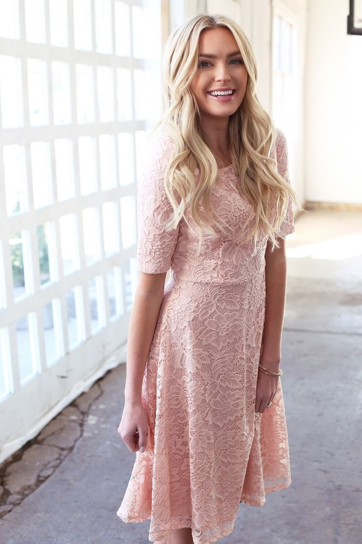 Pink lace! Such a feminine style, keeping it classic with a high neckline and elbow length sleeves, such a popular midi length dress from Omika.