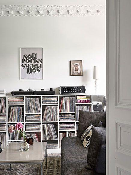 #interior #decor #styling #modern #livingroom #lounge #bookshelves #shelves #storage #frames #posters #pictures #cushions #white #grey