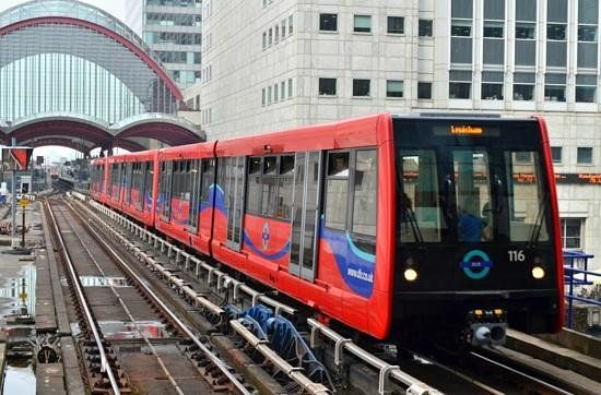 Docklands Light Railway (above ground railway, accepts Oyster cards and Travel cards) - London, England