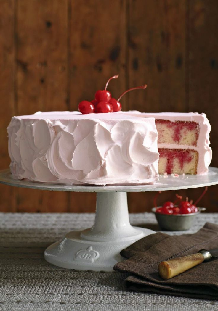 """JELL-O Poke Cake – This cake has seen its share of birthdays, holidays, and company parties, and it's always greeted with a """"wow!"""" Surprise 'em at your next gathering with this classic dessert."""