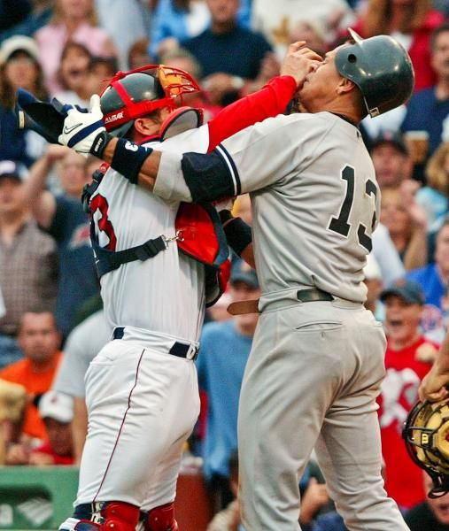 Boston Red Sox catcher Jason Varitek, left, shoves New York Yankees Alex Rodriguez in the face after Rodriguez was hit by a pitch during the third inning and began yelling at Red Sox pitcher Bronson Arroyo at Fenway Park in Boston on July 24, 2004. Rodriguez and Varitek were both ejected from the game after the benches cleared.  (Winslow Townson/AP)