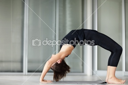 Woman at the gym arching her back on a yoga mat © Yuri Arcurs #3464597  You can get this image starting from $1.00