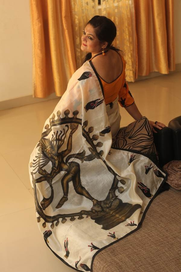 Natural tussar silk saree with the classical indian dance mudras ( hand formations) with the Lord of dance, Lord Nataraja painted on the pallu. Graceful and Unique . Embodies the Indian traditional ethos.