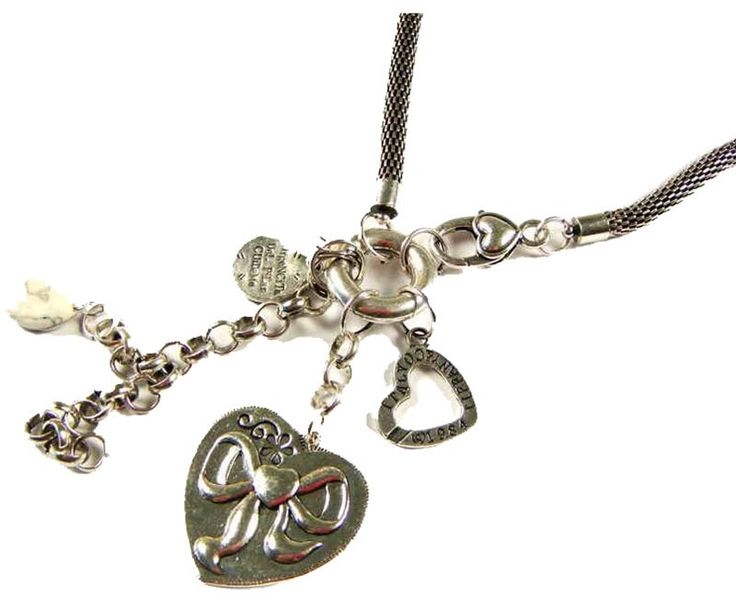 This adorable silver necklace comes with a few trinkets on the end including a beautiful silver bow heart. $6