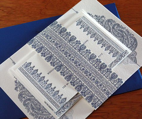 Blue envelopes compliment the color scheme in these Indian themed letterpress wedding invitations.