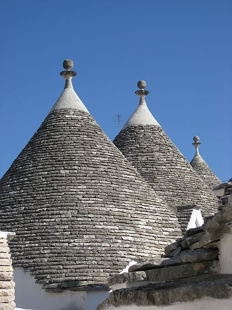 """""""Trulli"""" in Alberobello, Italy. Trulli are homes made of local limestone, stacked to make thick walls & spire-topped domed-roofs, without mortar, dating to the middle ages."""