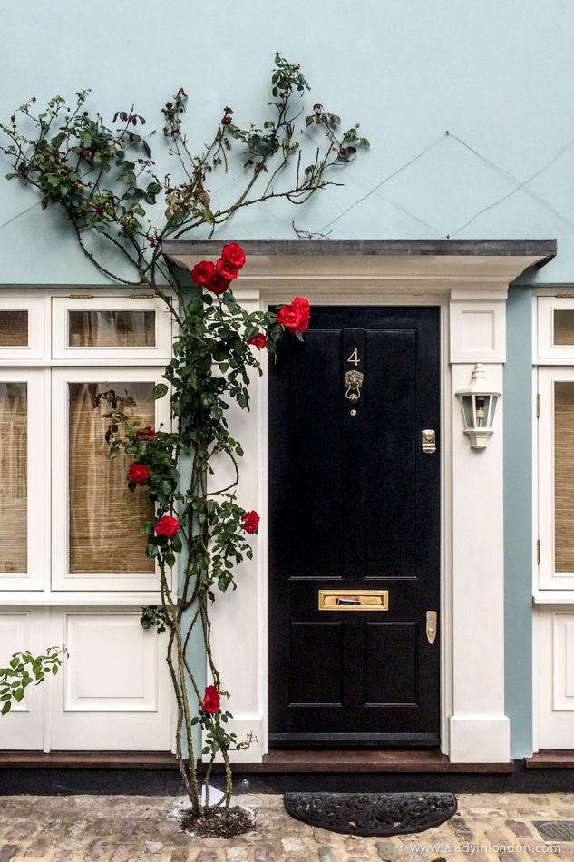 House with roses in Simon Close, Notting Hill, London