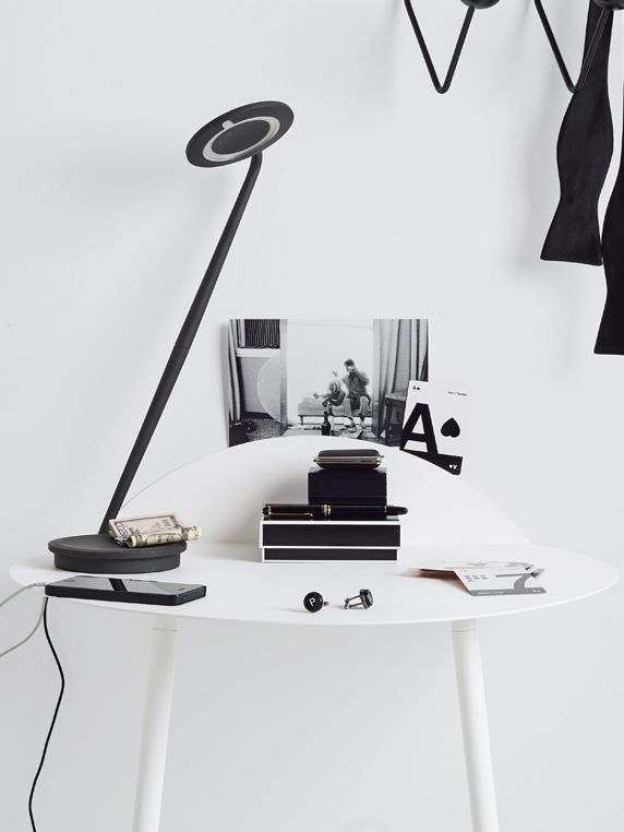 Pixo LED Table Lamp in Black. Available in eight playful colors, Pixo is infinitely adjustable and has a built-in USB port for charging your phone.