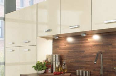 Dorset Kitchen Designs. Closest pic I could find to SemiGloss Cream Slab cupboard doors. as in, these are way too shiny...  Looking at it, am wondering about those dark wood tops I rejected out of hand.... Anyway, I was thinking of this cream with Travertine worktop.