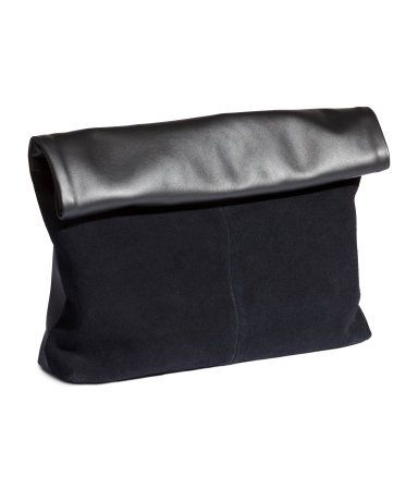 Soft clutch bag with suede at front and imitation leather at back. Top zip and foldover flap with magnetic closure. Lined. Size approx. 9 x 14 1/4 in.