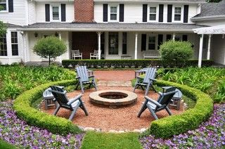 Landscaping and pebbles around fire pit
