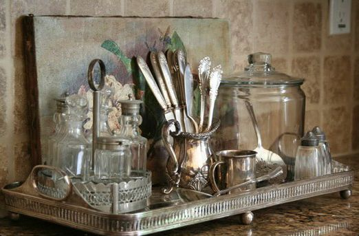 LOVE this look... a collection of kitchen items on silver tray.  Want to do this by my coffee maker.