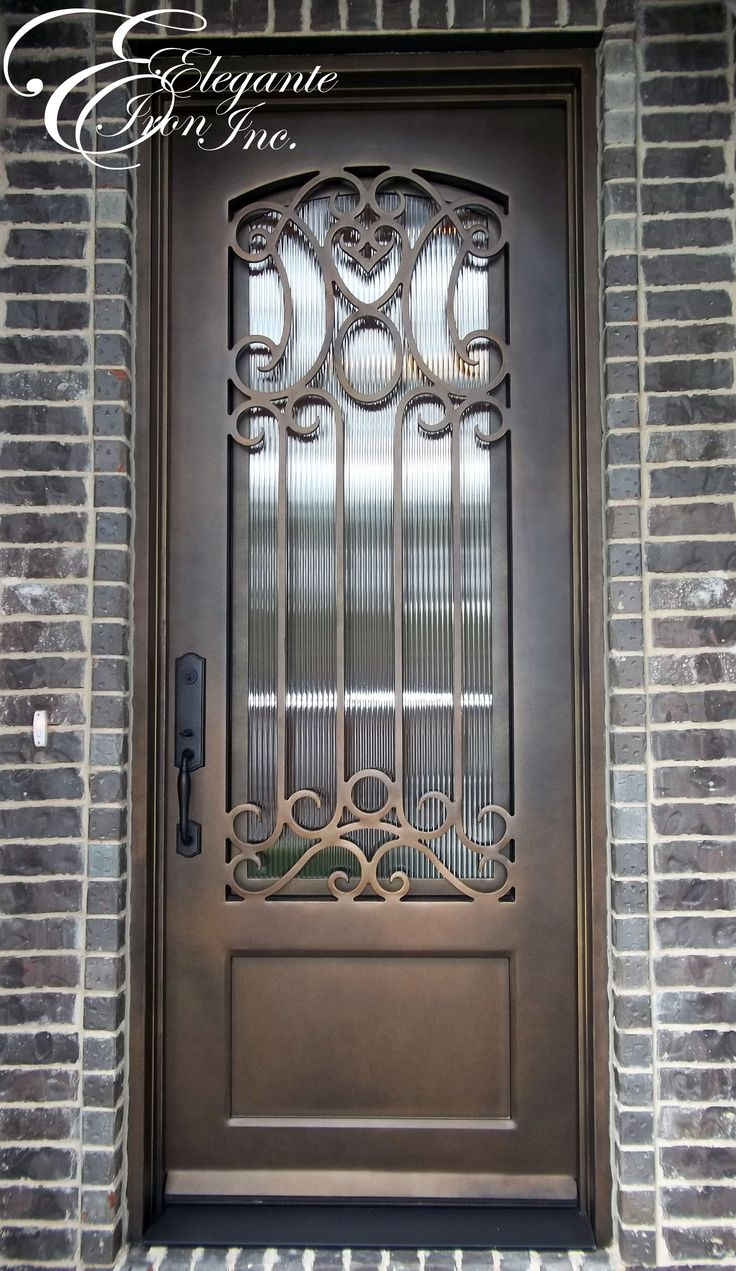 Wrought Iron Door With Eyebrow Arch Grille.