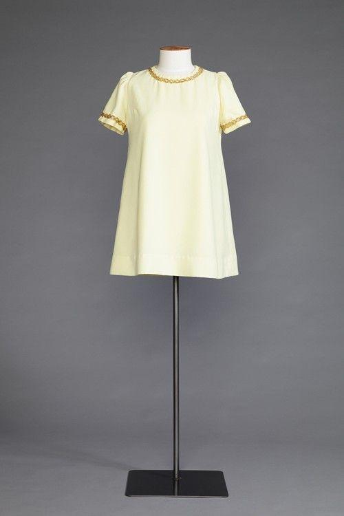 Yellow mini dress by Judy Sherriff