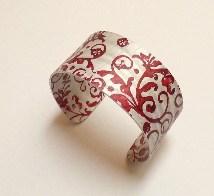 Cuff | KilnFiredArt. Anodised aluminium, hand stamped, painted and textured .