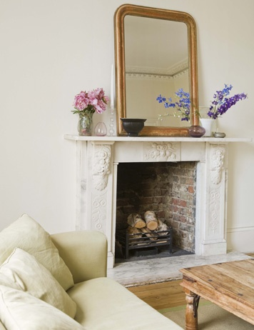 Authentic Exposed Brick Lines The Inside Of An Antique Stone Fireplace,  Adding A Vintage Touch