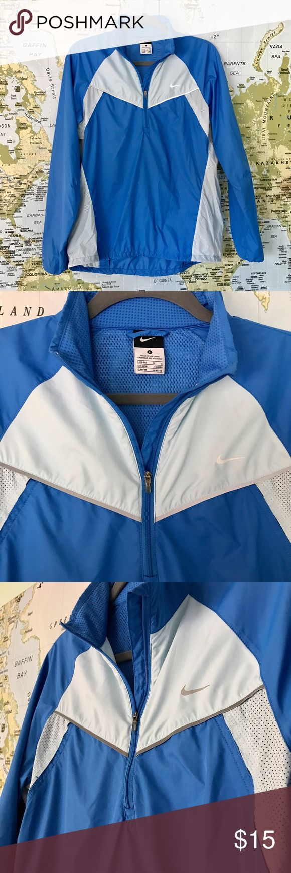 Blue/Light Blue Nike Running Jacket/Windbreaker Size Large Blue and Light Blue Nike Running Jacket. Excellent Condition. Small pocket in back. Silver reflecting strips located on the front and back of the jacket. Light material, 100% Polyester. Nike Jackets & Coats
