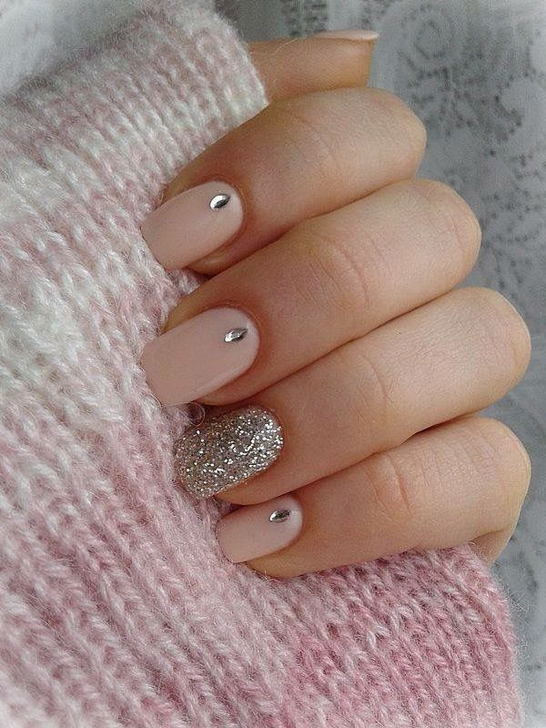 Nude nails with gems and silver sparkle accent