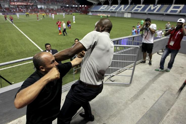 Costa Rica coach Paulo Wanchope (R) is pictured fighting with a security guard during the Olympic qualifying match between Costa Rica amd Panama at the Maracana stadium in Panama City August 11, 2015. Wanchope resigned on Wednesday after being involved in a brawl with a security guard at the end of an Olympic qualifying match against Panama. Wanchope, who was observing the match in Panama City between the respective countries' under-23 teams, was shown in video footage to retaliate after…