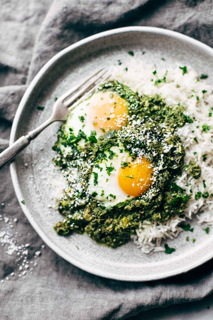 Creamy Green Shakshuka with Rice - 30 minute recipe made with cilantro, parsley, jalapeno, olive oil, almond milk, eggs, and rice. Breakfast, lunch, OR dinner! | pinchofyum.com #AD