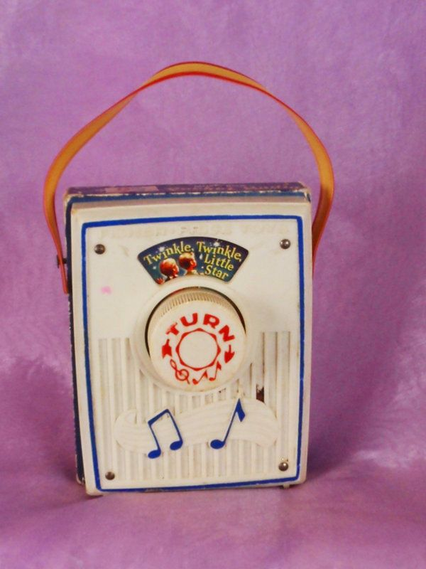 Fisher Price Radio. Wow, I'm stunned. Never would have remembered this toy if I hadn't seen the pic. I looooooooooved this thing!!! I remember playing it over and over and over. I know this is corny but I really love this song. I've always sang it to my girls when I was rocking them at night. I wonder if it's b/c I listened to it a million times when I was little. That's so awesome!