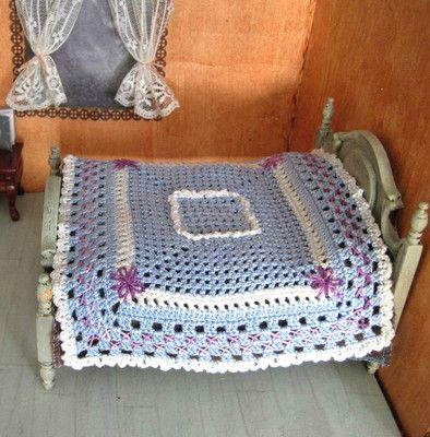 blue and white miniature crochet dollhouse bedspread. Sold, but visit my website Pugcentric Pursuits.
