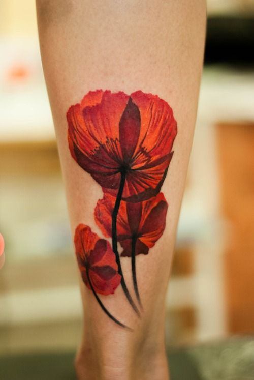 Red orange poppy tattoo.  Done by Denis Sivak, L.O.V.E. machine tattoo studio, Odessa, Ukraine