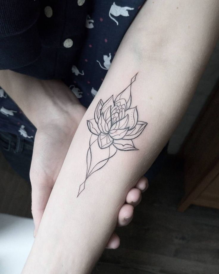 Ornamental lotus tattoo by dasha_sumtattoo.   These blackwork tattoos are the most exquisite creations by some of the most renowned tattoo artists out there for your pleasure. Enjoy!