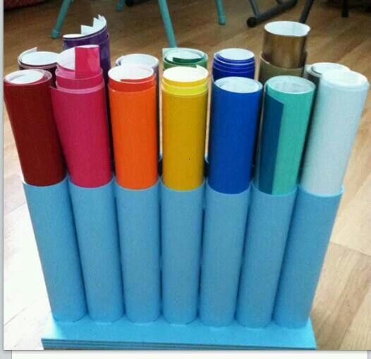 PVC pipe glued to a piece of wood to store vinyl rolls: