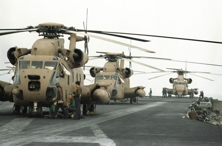 Operation Evening LightThree RH-53 Sea Stallion helicopters are lined up on the…
