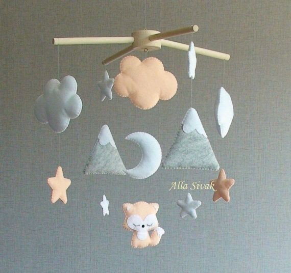 This is a a cute fox woodland nursery mobile. Its perfect for decorating nature inspired woodland nursery room and its suitable for neutral gender nursery.  Its perfect for new born gift, shower gift and nursery room decoration. All completely hand sewn.  It features a 1 fox, moon,