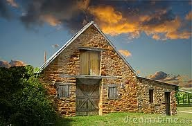 stone barn at sunset