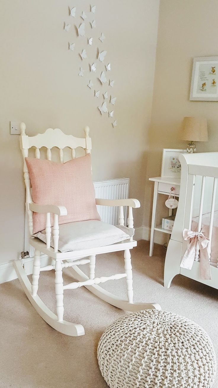 Rocking chair in Emilia's nursery. 3D butteryfly decals on wall. Knitted footstool. More pictures on nursery blog...