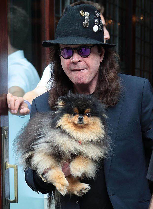 Ozzy Osbourne with his pet Pomeranian