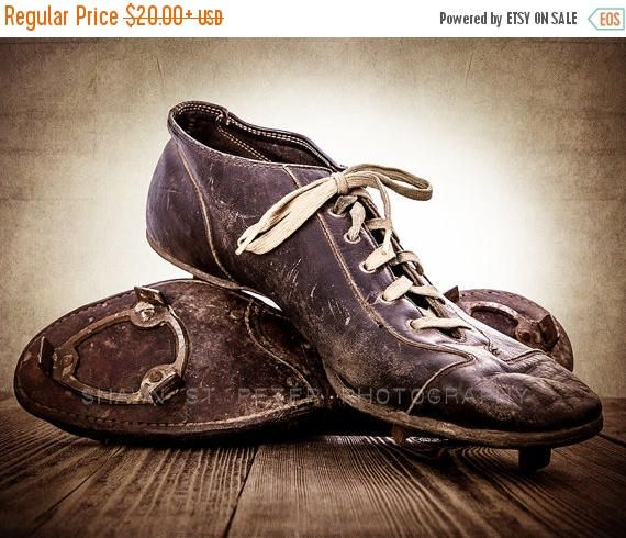 This listing is for One print of some very old leather football cleats. I found these in an old basement of an estate sale. I wonder how many games have been played in them and the stories they could tell. The brown, distressed tones will add so much warmth and character to your space. This would be a perfect print for your little boys room, nursery or a man cave!  Please select either photo or canvas as well as the size youd like from the drop down menu as you place it in your cart. Pricing…
