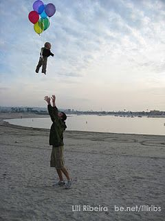 Cute idea! Give your baby some balloons (maybe looped around the wrist) and toss him in the air. :)
