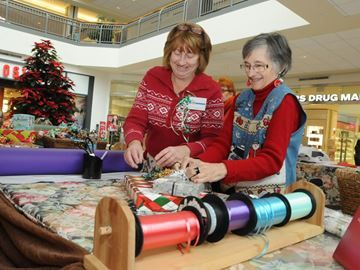 Time to wrap up your Christmas shopping in Barrie - Noreen Hamilton, left, and Carolyn Frid wrap at the Alzheimer Society of Simcoe County gift wrapping booth at the Georgian Mall.