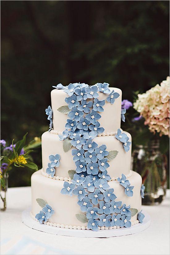 blue flowers on wedding cake