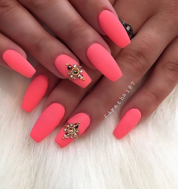 Hot pink matte coffin nails encrusted with jewels