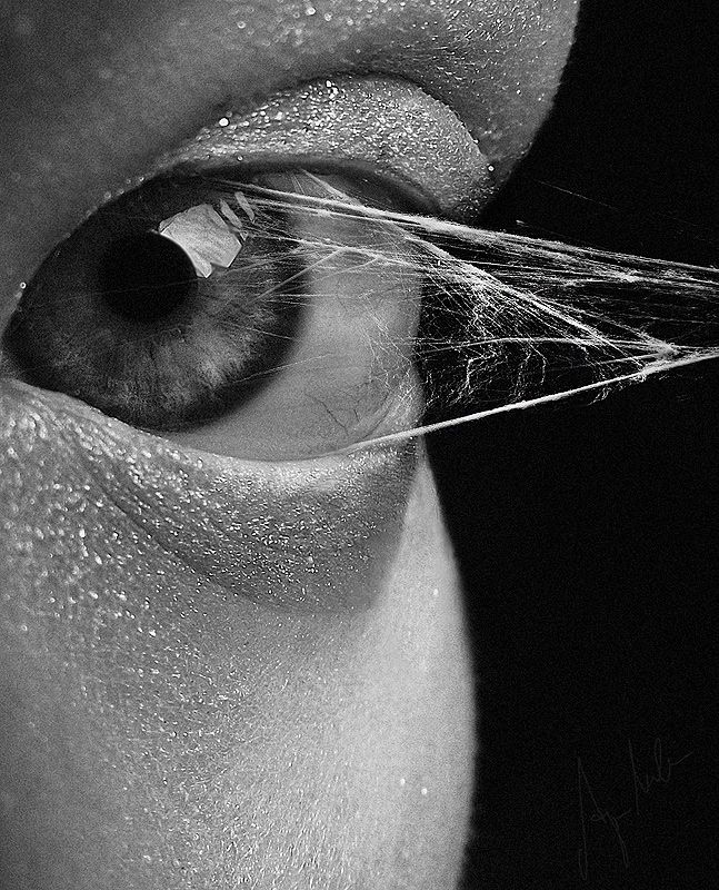 This is a really cool peice of digital design where they photoshopped in a cobweb being pulled from someones eye not only is it beautiful