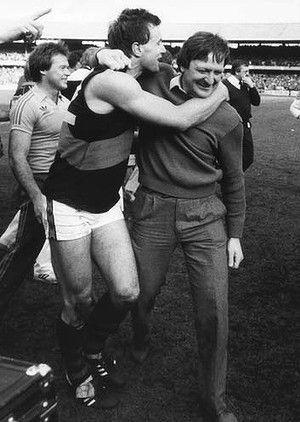 Youthful Bombers veteran Tim Watson hugs coach Kevin Sheedy after Essendon's premiership win, 30th September 1984.