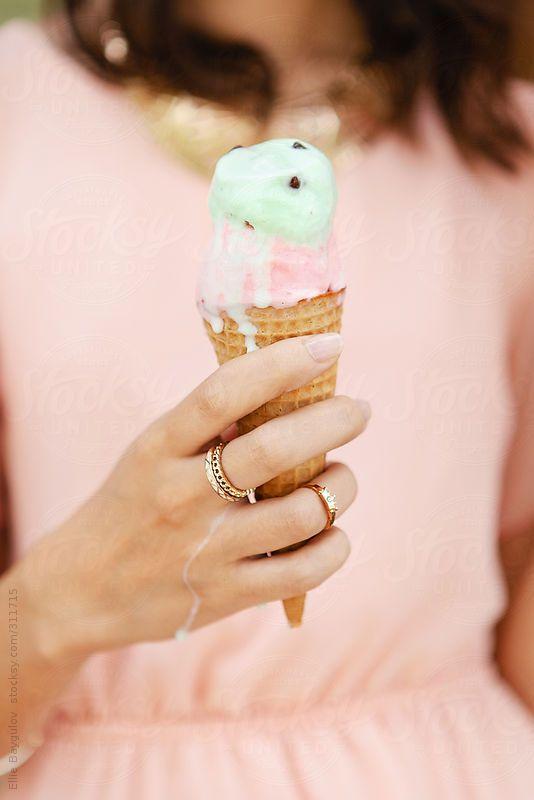 Girl holding melting ice cream